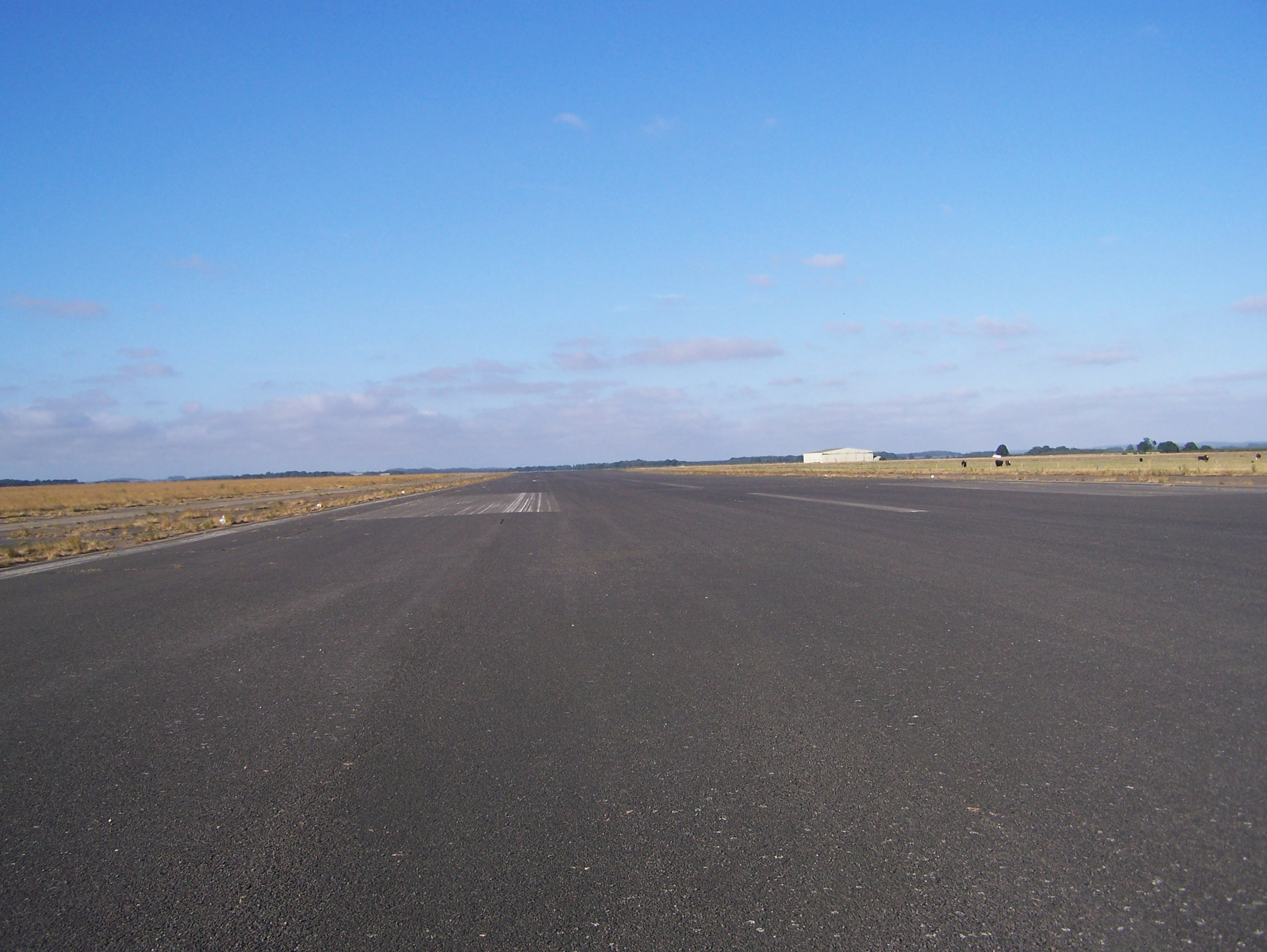 South-west end of 3,000 yards long 06:24 main runway 15:07:2006.JPG