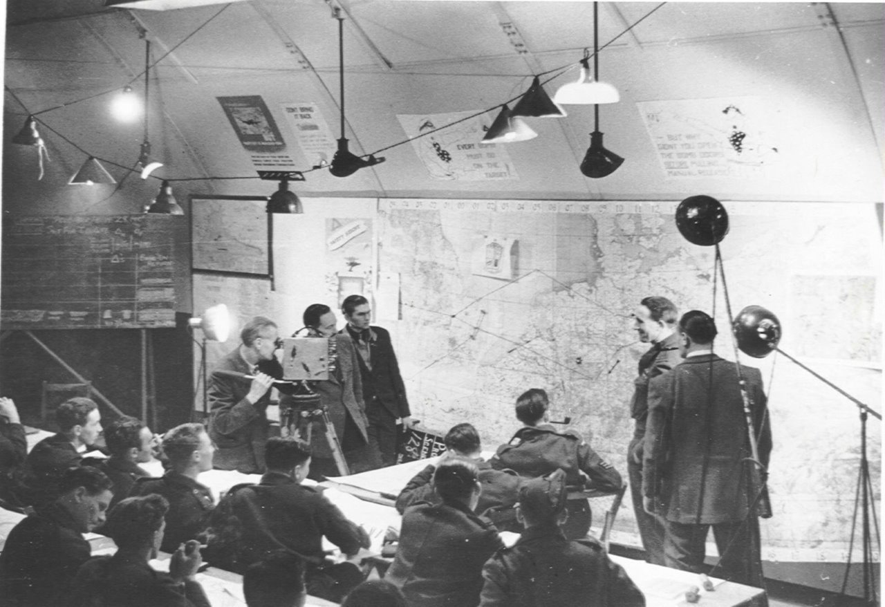 012FILM CREW AT RAF GRAVELEY IN THE BRIEFING ROOM 1944 PHOTO VI.jpg