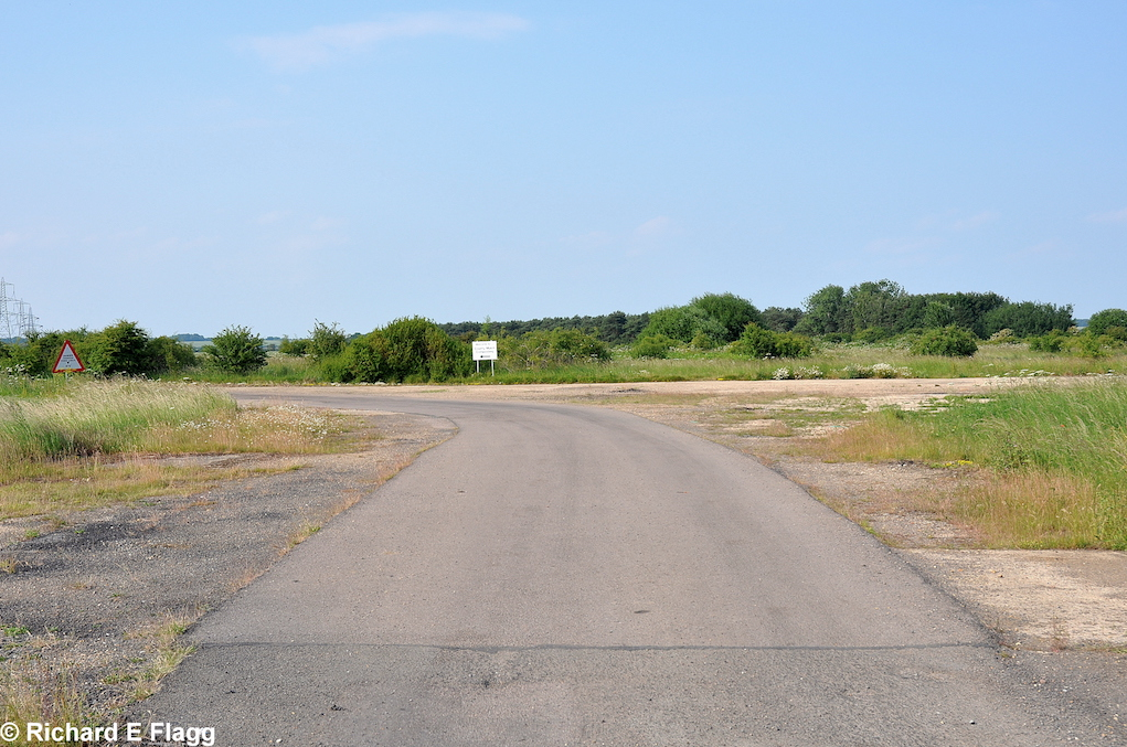 006Taxiway at the south west corner of the airfield. Looking north towards the runway 07 threshold from Tempsford Road - 26 June 2010.png
