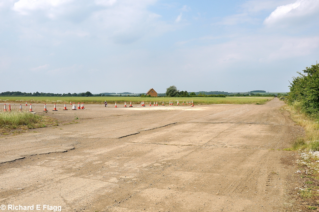 008Taxiway at the east of the airfield. Looking north at the runway 31 threshold - 26 June 2010.png