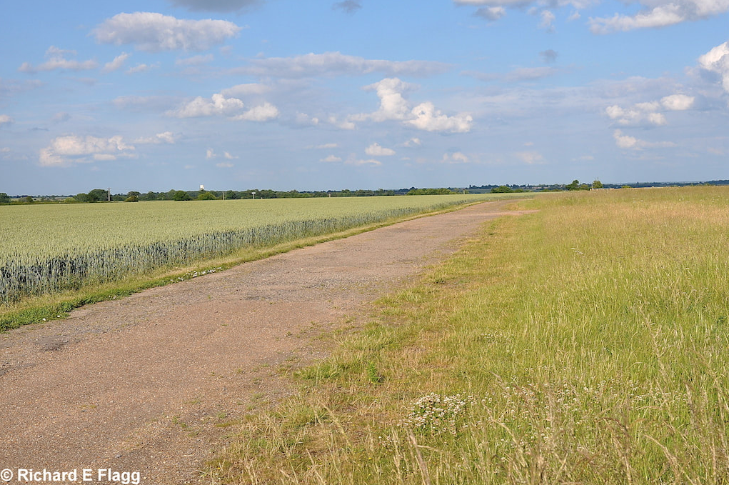 012Taxiway at the south of the airfield. Looking east from near the Control Tower - 24 June 2010.png
