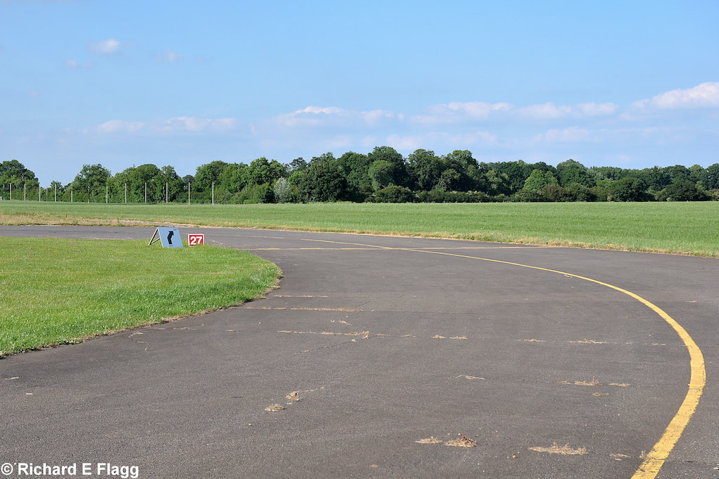 007Taxiway at the south of the airfield. Looking north towards the runway 28 threshold - 25 June 2010.png