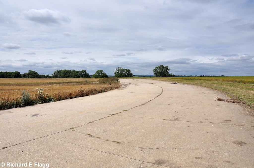 007Taxiway at the north of the airfield. Looking west at the runway 19 threshold - 24 July 2010.png