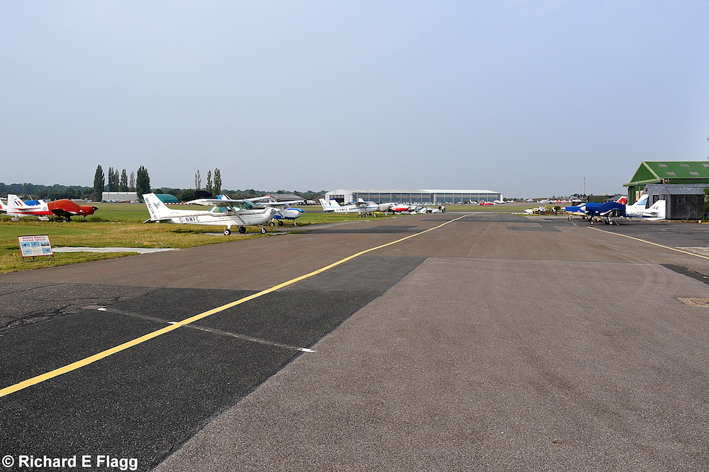 010Taxiway at the centre of the airfield. Looking west near 'The Squadron' - 19 September 2009.png