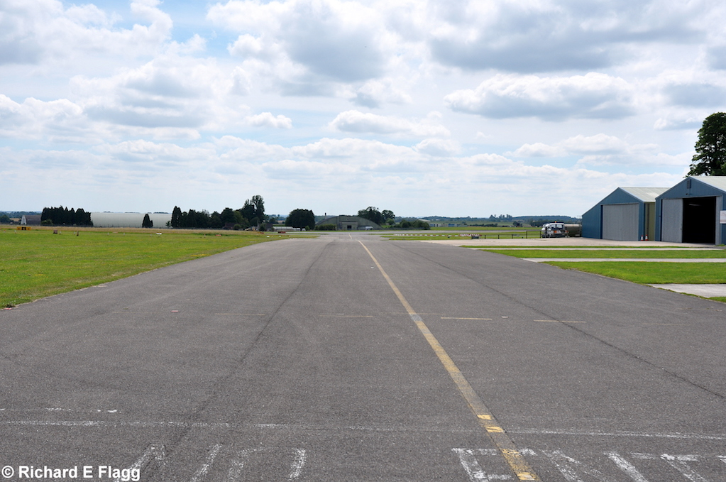 017Taxiway at the north of the airfield. Looking south west near the control tower - 17 July 2014.png