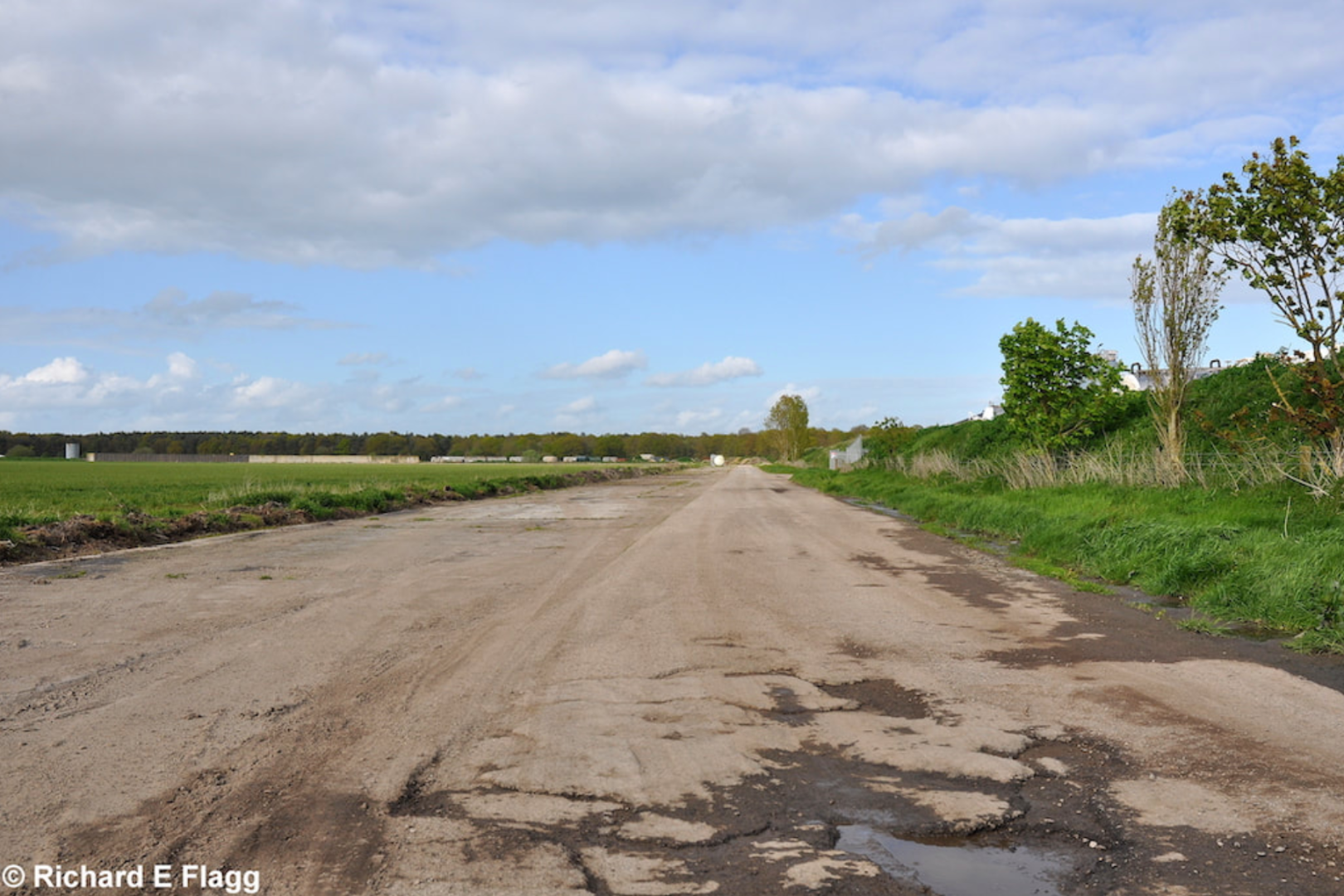 004Taxiway at the south of the airfield. Looking north east from near the control tower - 15 May 2012.png
