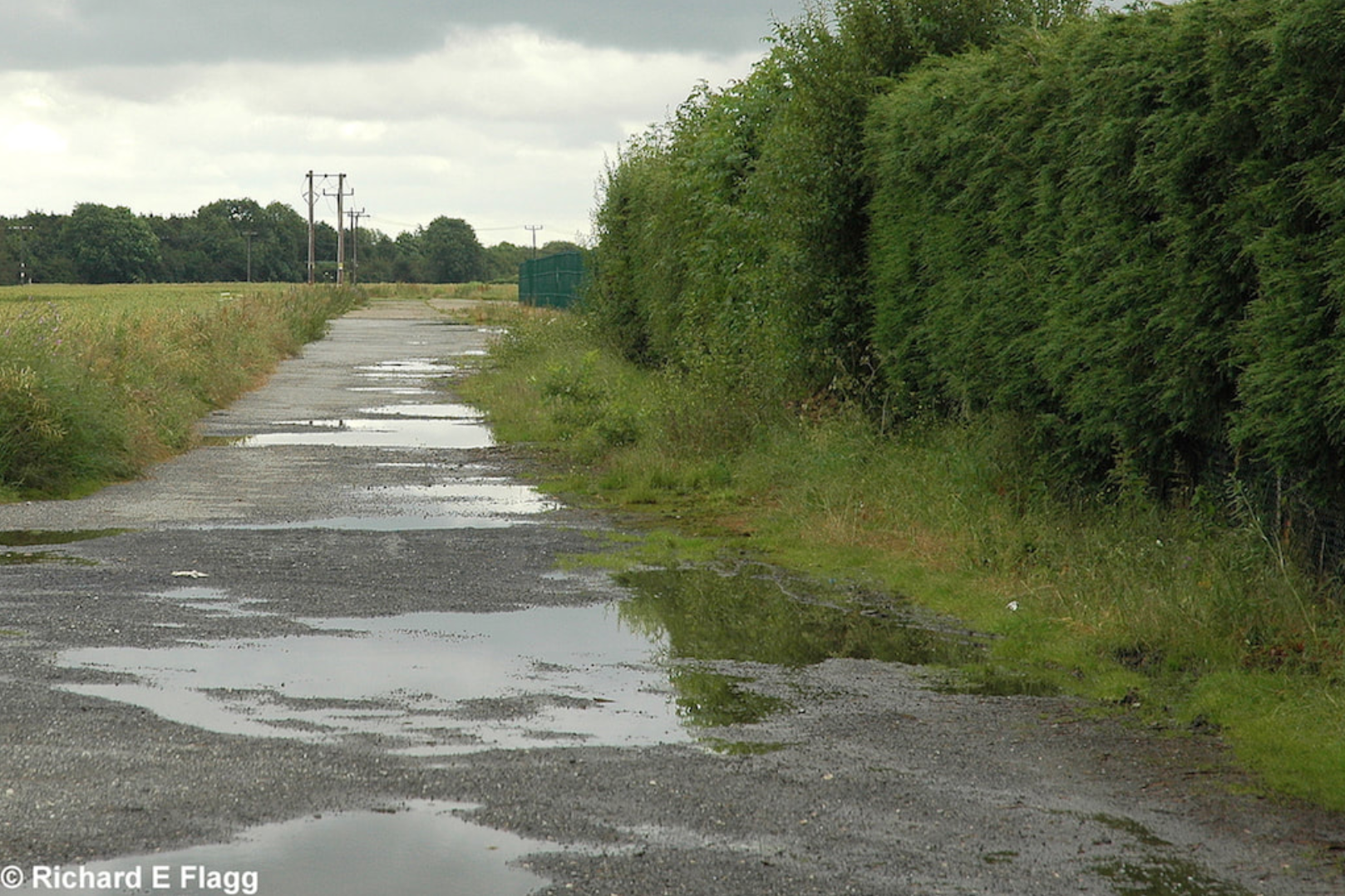 004Taxiway at the south of the airfield. Looking east from Reepham Road - 1 July 2007.png