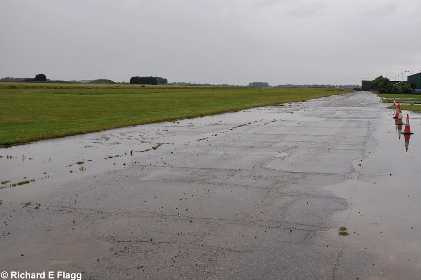 003Taxiway. Looking west from near the Hangar - 6 July 2014.png