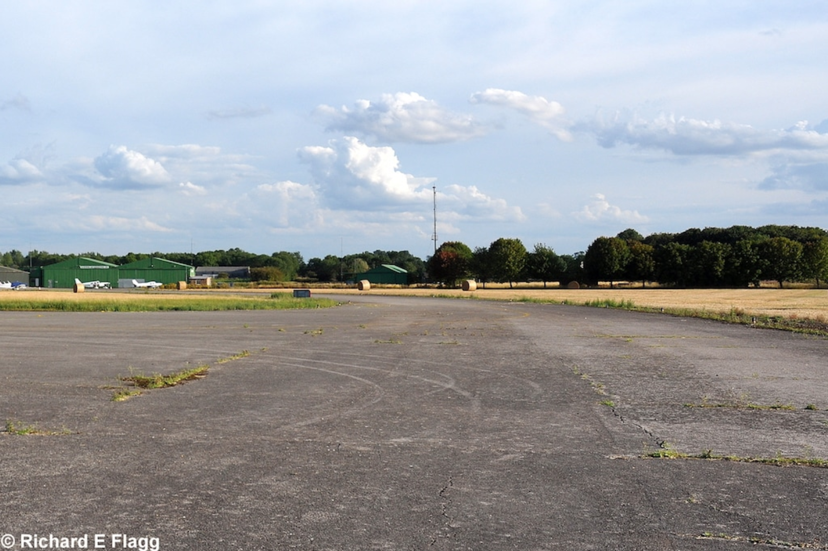 013Taxiway at the west of the airfield. Looking south from the runway 08 threshold - 25 August 2011.png