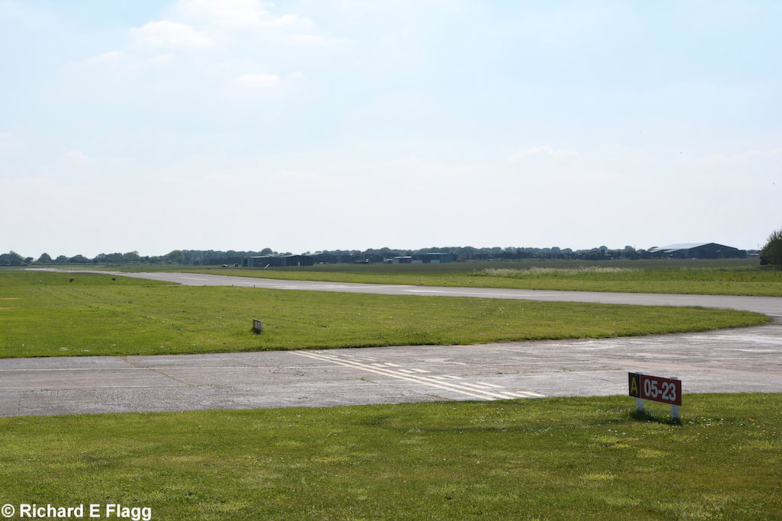 004Taxiway at the east of the airfield. Looking south west. This is now the active runway 05:23 at Sandtoft - 25 May 2017.png